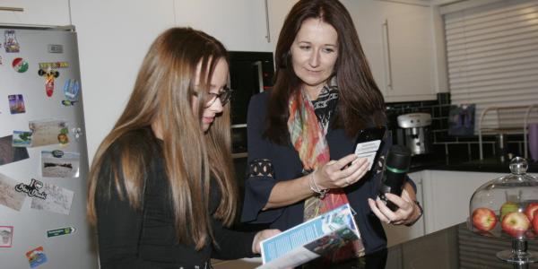The McKellar family trying Polytag's app